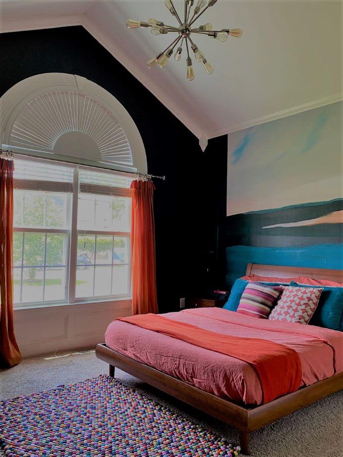 Guest bedroom painted dark with mural