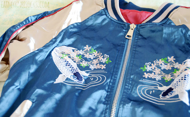 Details on the blue, gold, and red Japanese koi fish embroidered oversized bomber souvenir jacket from Romwe, a SS16 fashion trend.