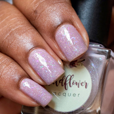 Light purple jelly polish with shift flakes on dark skin.