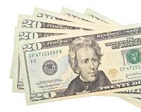 $20 bills arranged in a fan on a white background