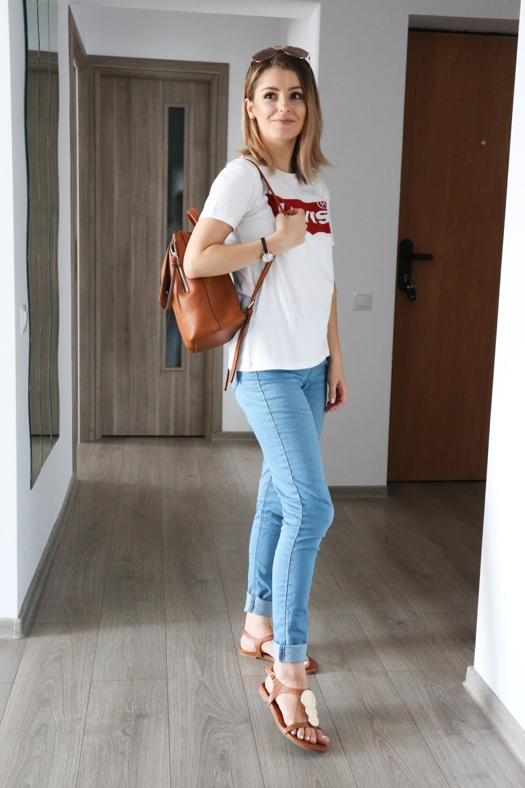 Levi's t-shirt with light wash jeans and sandals