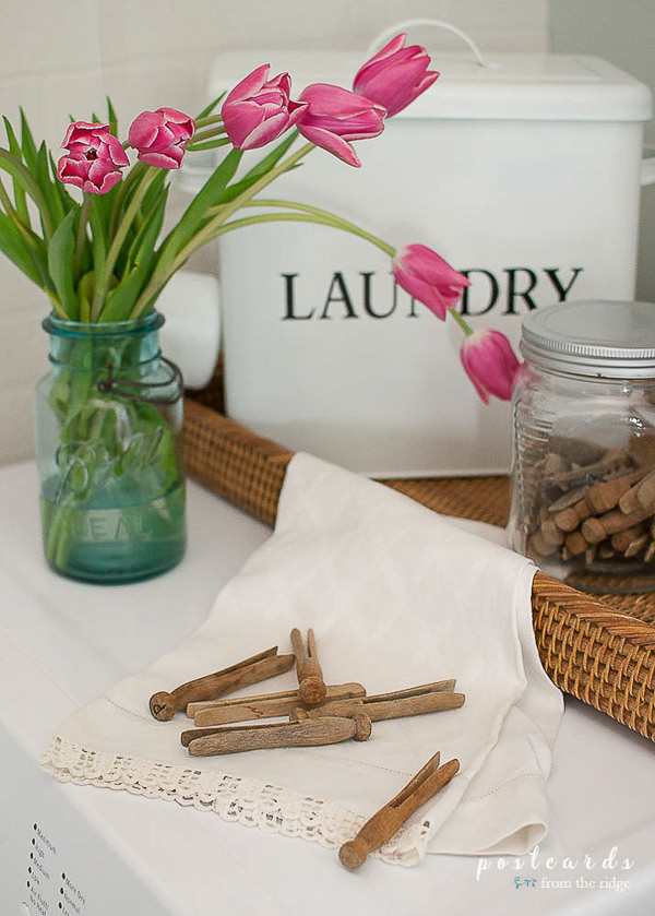 pink tulips in a vintage blue mason jar in a laundry room