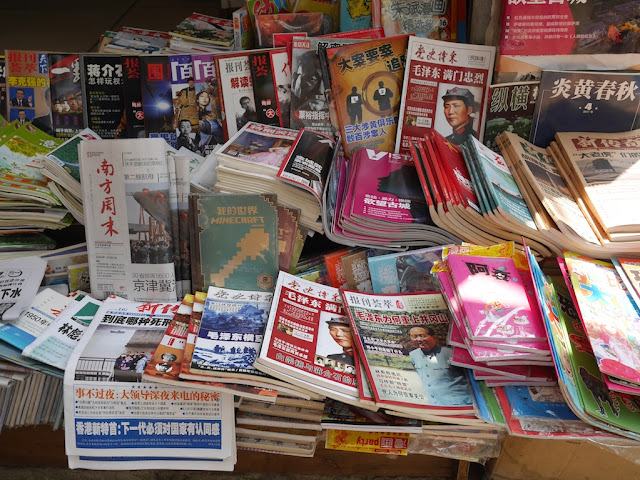 Mao-themed magazines along with a book about Minecraft