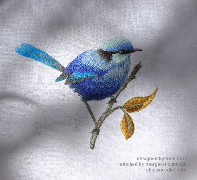 Thread painted blue bird showing how colours change in sunlight