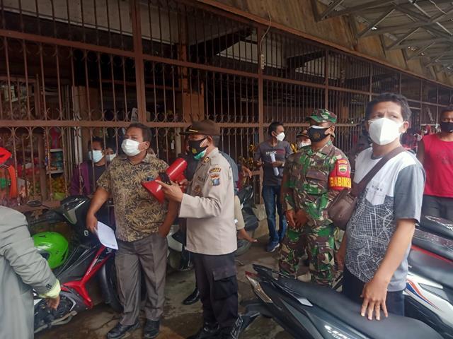 Ditempat Keramaian, Personel Jajaran Kodim 0207/Simalungun Laksanakan Ops PPKM Level 4
