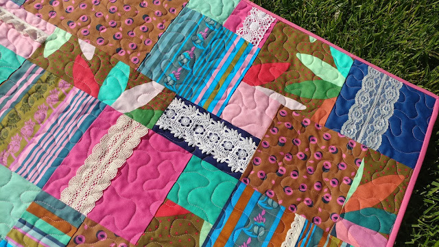 Boho Chic baby quilt with Anna Maria Horner fabrics and vintage lace