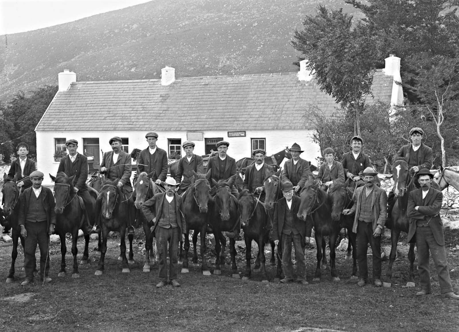 Men on horseback in front of Kate Kearney's Cottage in Kerry. 1900.