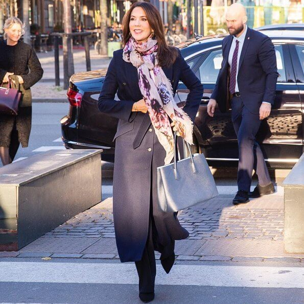 Crown Princess Mary wore a trench coat by Fonnesbech, and high-heel boots by Pura Lopez, and gold earrings by Marianne Dulong. Prada Saffiano bag