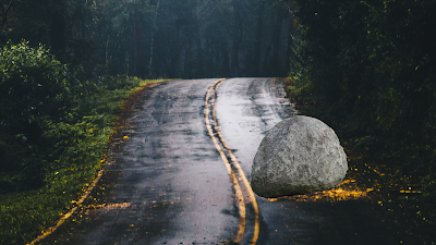 A boulder placed by the king on the road a moral story