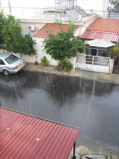 Raindrops falling in the street, torrential rain in Cyprus in September