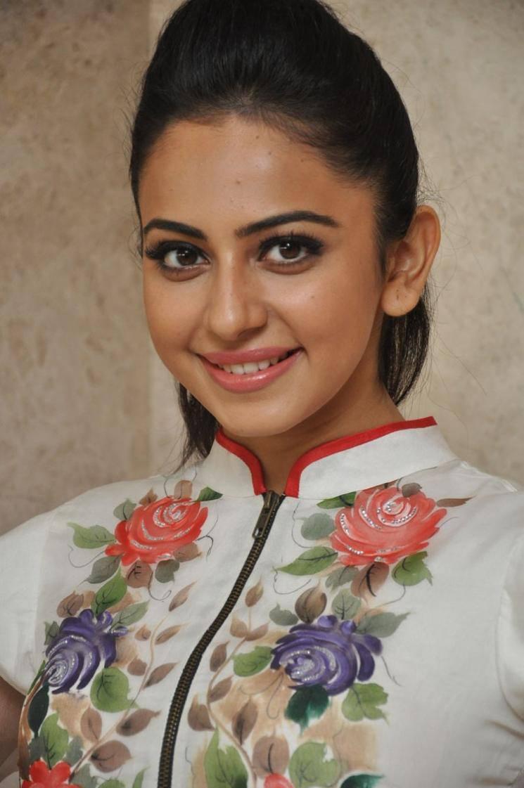 Rakul Preet Stills At Movie Success Meet In White Dress