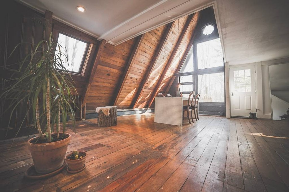04-Dining-Room-and-Entrance-Jeremy-Sustainable-Catskills-A-Frame-House-Airbnb-www-designstack-co