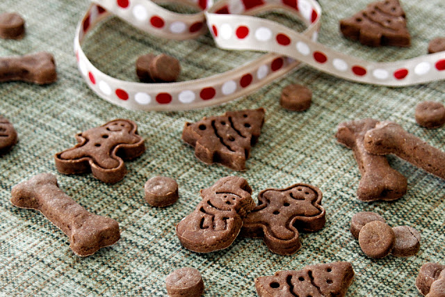 Christmas dog treats shaped like bones, trees, gingerbread men, and snowmen