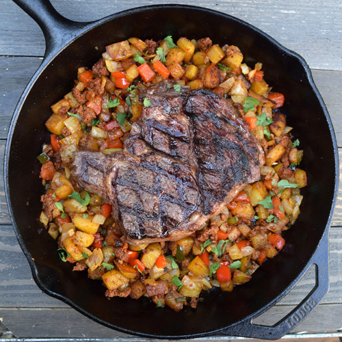 Ribeye steak with chroizo hash cooked on the grill.