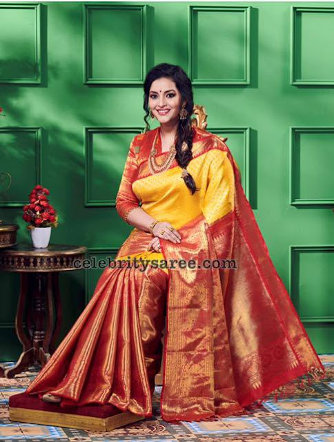 Renu Desai in Mustard Yellow Silk Saree