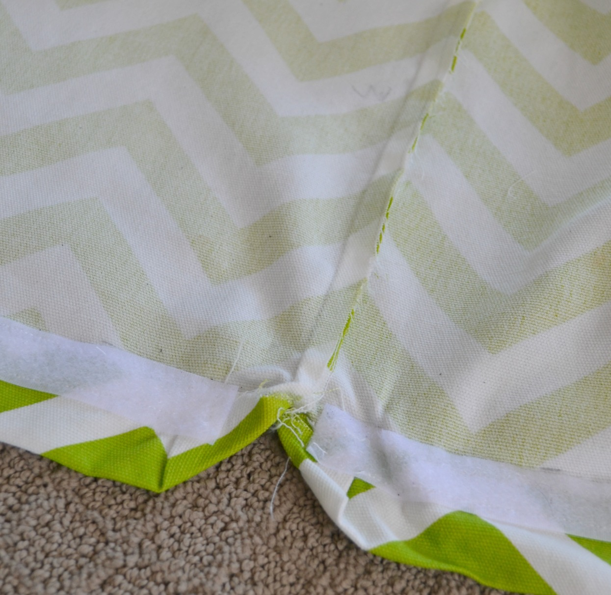 DIY Ottoman Slip Cover that can easily be removed and washed. How kid friendly is that? Click through for the full tutorial.