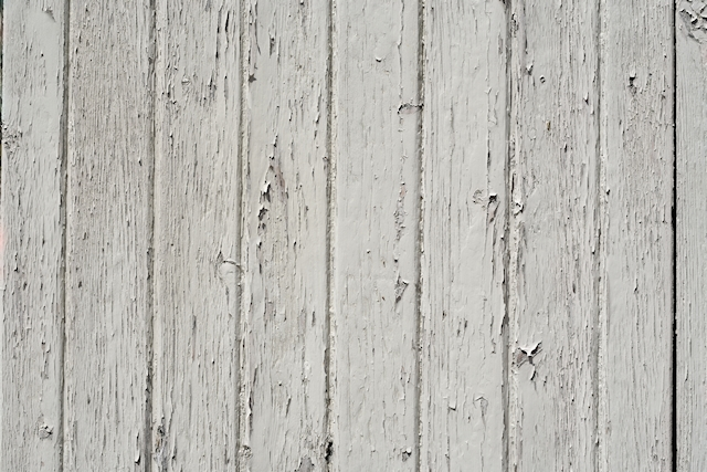 Chipped white paint on wood texture
