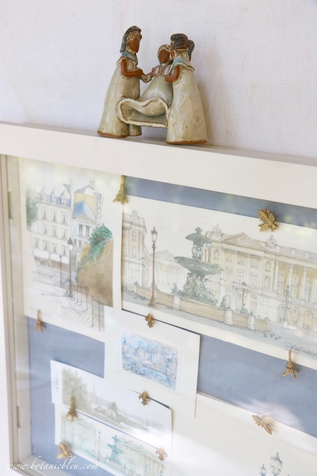 Add a small handmade clay figurine to the top of a shadowbox