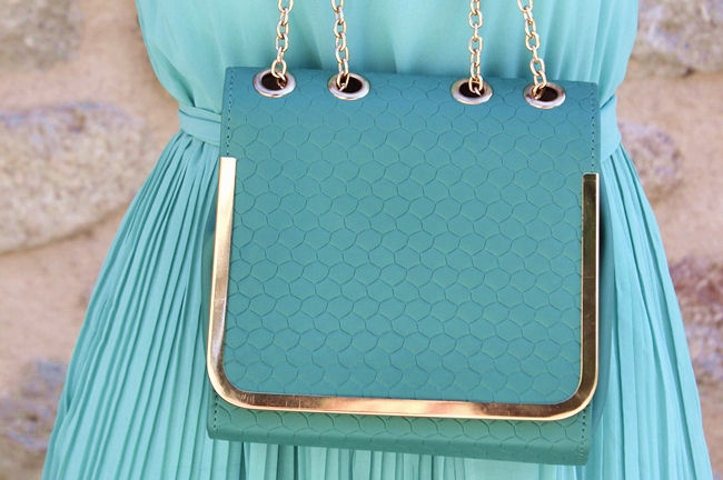 mint green purse with gold chain