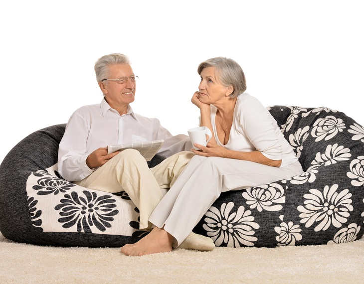 Elderly Couple Sitting on Gel Pressure Relief Cushion