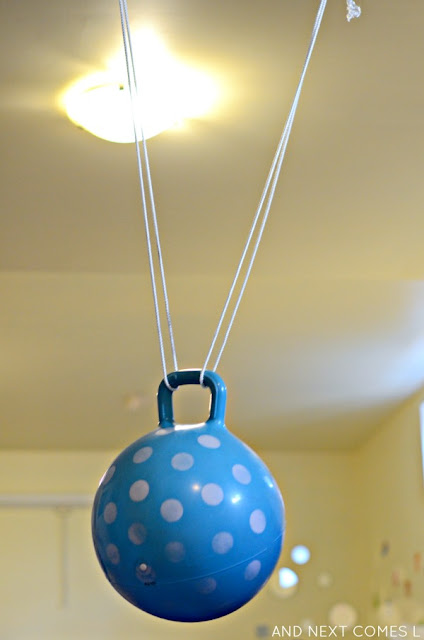 DIY ball swing hanging up in a basement