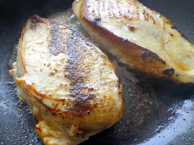 Season chicken fillets on both sides and fry