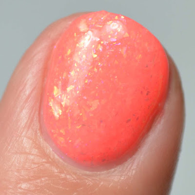 coral flakie nail polish close up swatch