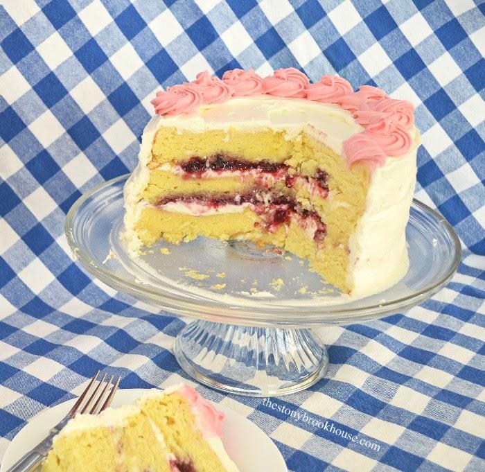 Close up of White Chocolate chip Raspberry filled lemon buttercream cake