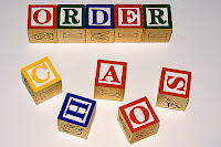 "image of blocks spelling ""order"" and ""chaos"""