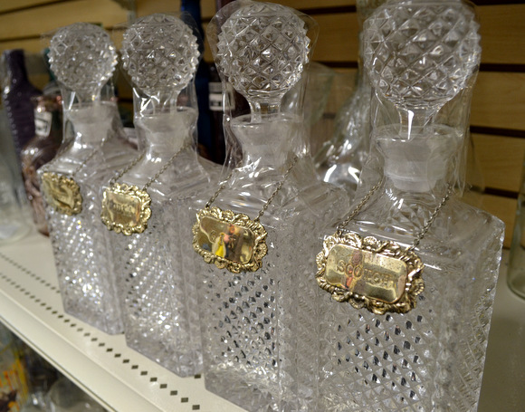 four decanters for alcohol