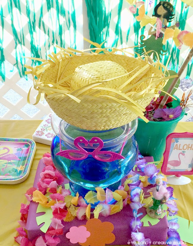 straw hat at luau party, flamingo, leis, aloha sign, luau graduation