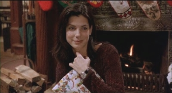 Sandra Bullock finds happiness from stockings all hung by the chimney with care in WHILE YOU WERE SLEEPING (1995)