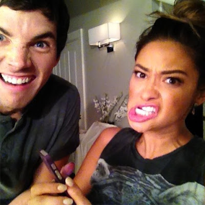 Shay Mitchell and Ian Harding making funny faces on PLL set