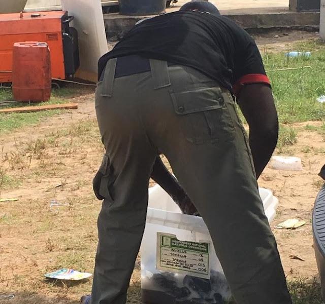 Hilarious: See Photos Of Policeman Using Ballot Box To Wash Uniform In Bayelsa