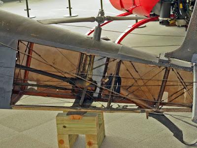Side of fuselage is open so tail rotor mechanism is seen.
