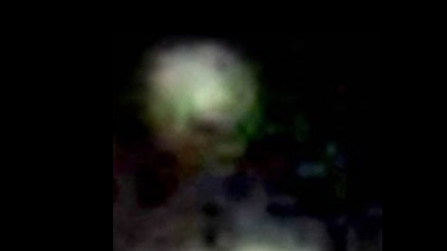 Picture of the Alien stood at the window of the UFO over Turkey.