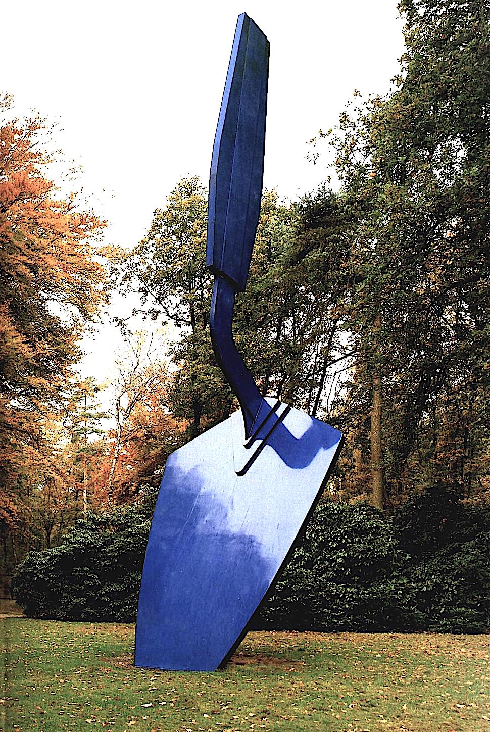 a Claes Oldenburg sculpture of a giant blue trowel stuck in a lawn