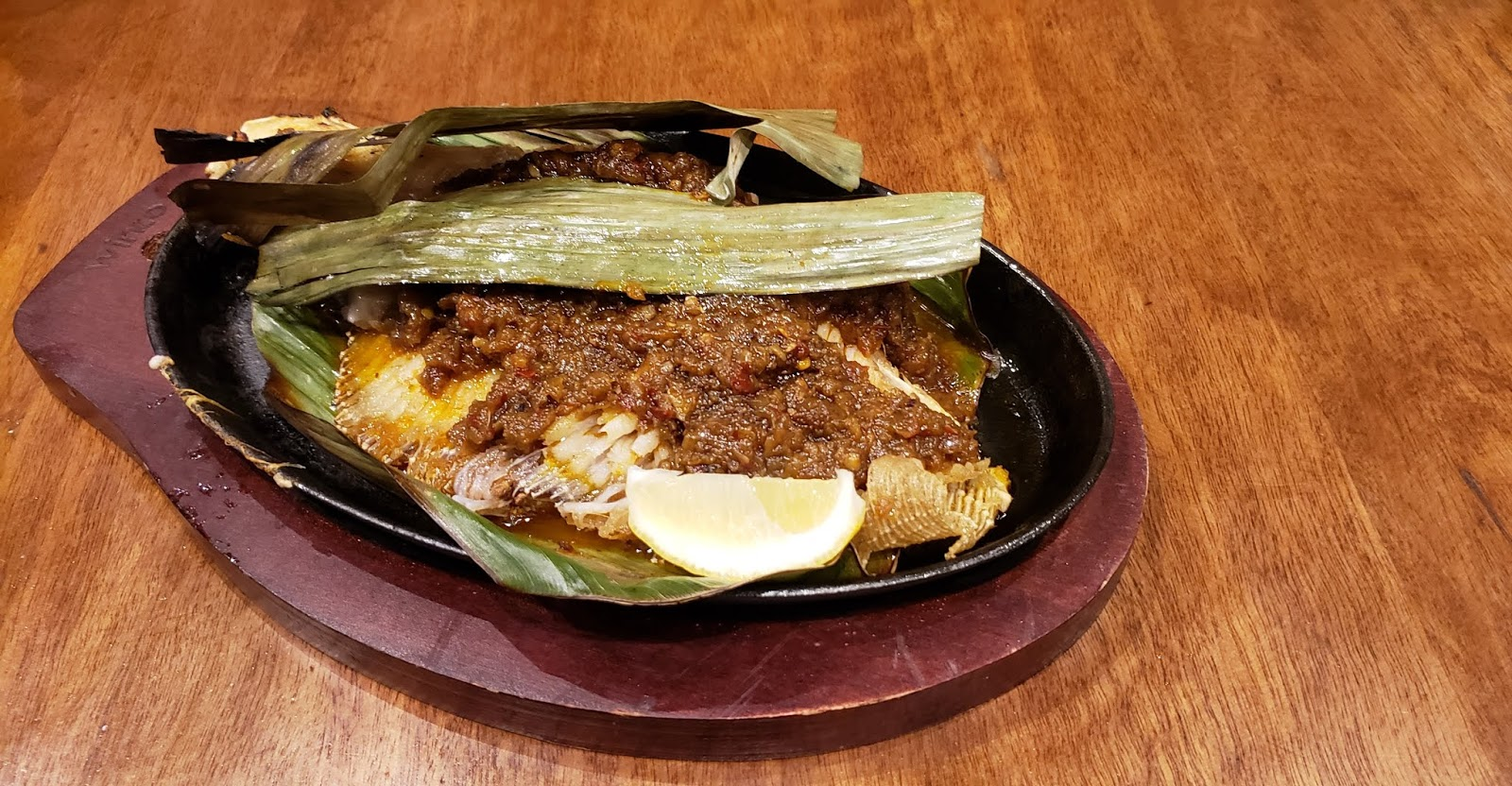 Sizzling Stingray Fish served on Banana Leaf