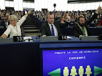 European lawmakers (left to right) Francoise Grossetete of France, Manfred Weber of Germany and Jozsef Szajer of Hungary vote in favor of the Paris climate change agreement on Tuesday. (Credit: Jean-Francois Badias/AP) Click to Enlarge.