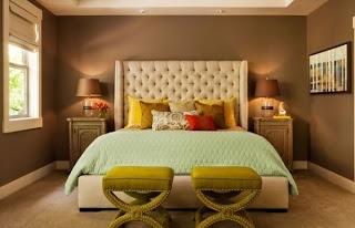 Dormitorio verde con marrón