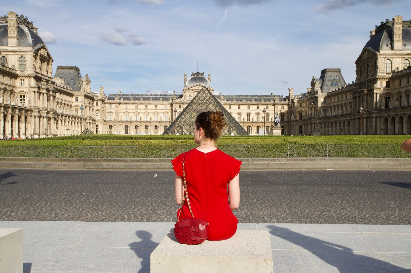 Fashion blogger Kathleen Harper outside the Louvre in Paris France