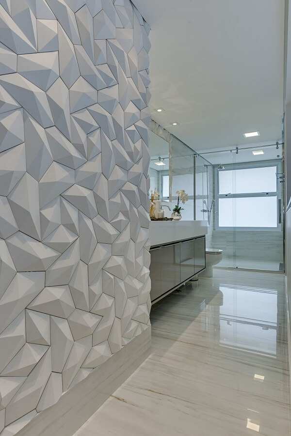 The shapes of the 3D bathroom tile bring movement to the space