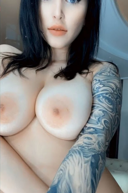 naked tattooed woman with big tits