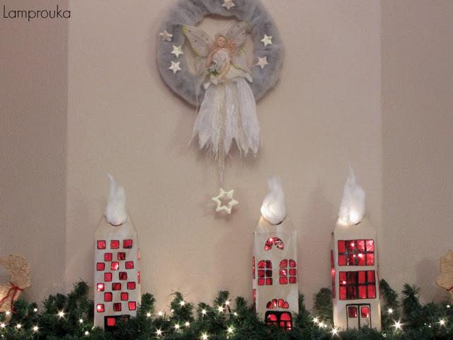 Χριστουγεννιάτικη διακόσμηση τζακιού με χάρτινα σπιτάκια.