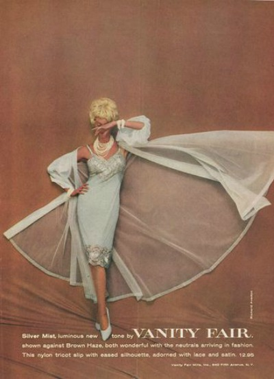 Vanity Fair Lingerie Ad from 1959 with model wearing white peignoir