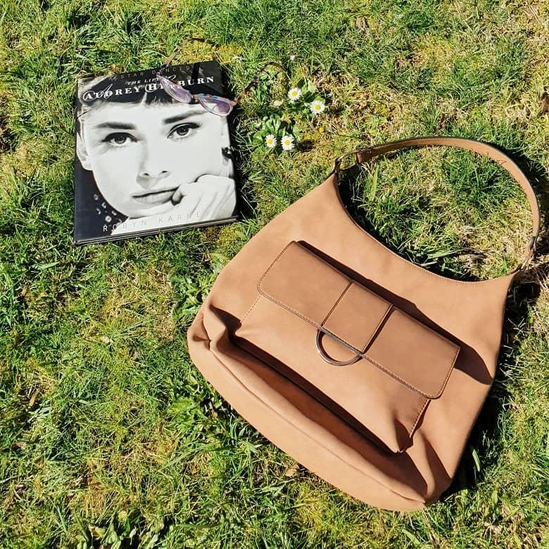 Audrey Hepburn book, and handbag