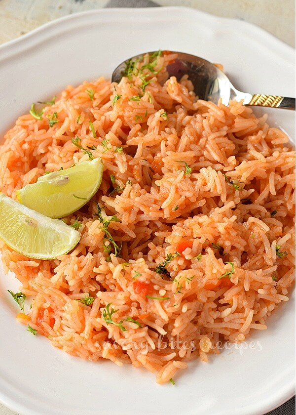 a close up of a white plate with restaurant style mexican rice