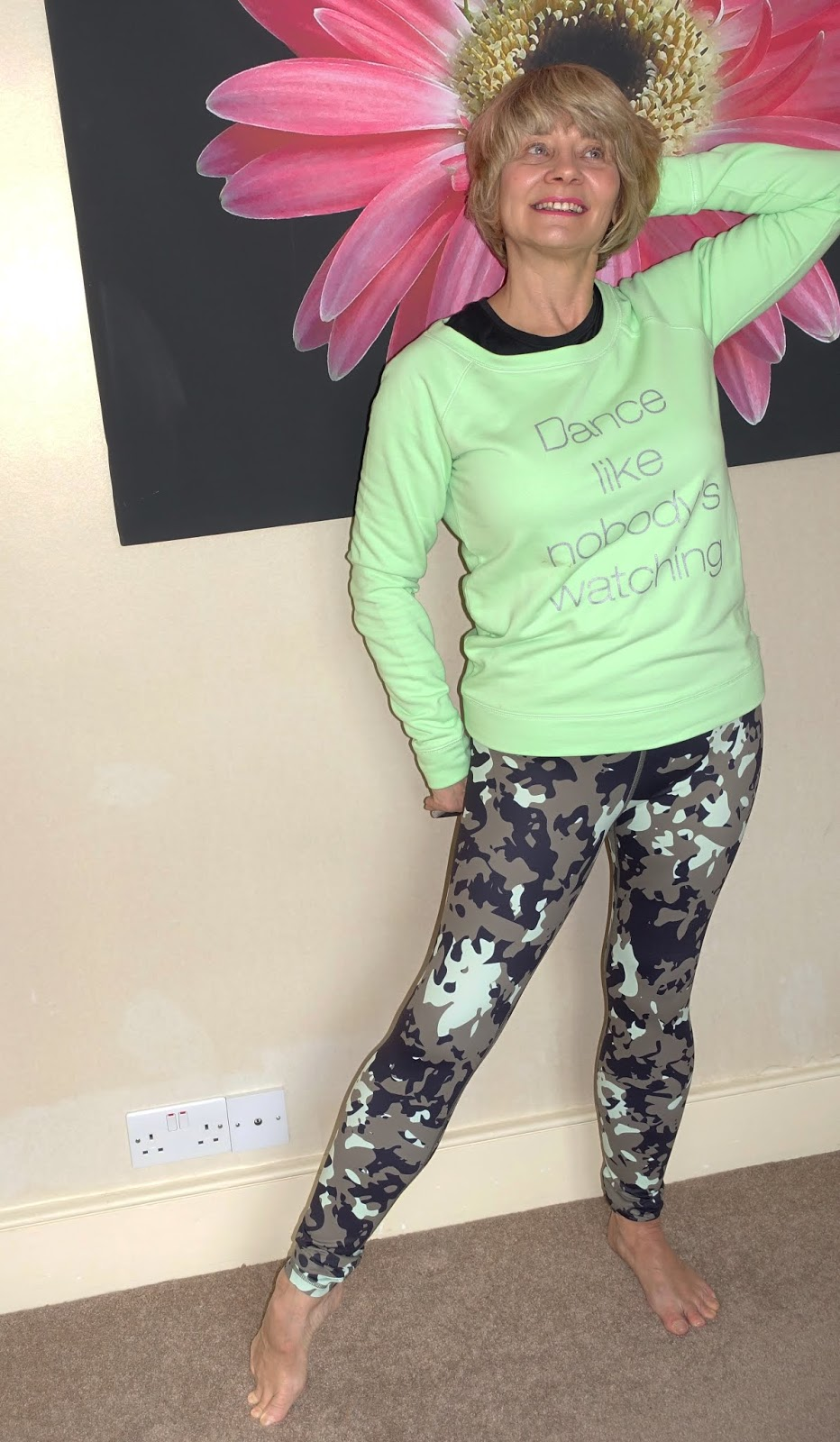 Over 50s fashion blogger Gail Hanlon in gym kit from Yoga Leggs - green sweatshirt and camo leggings