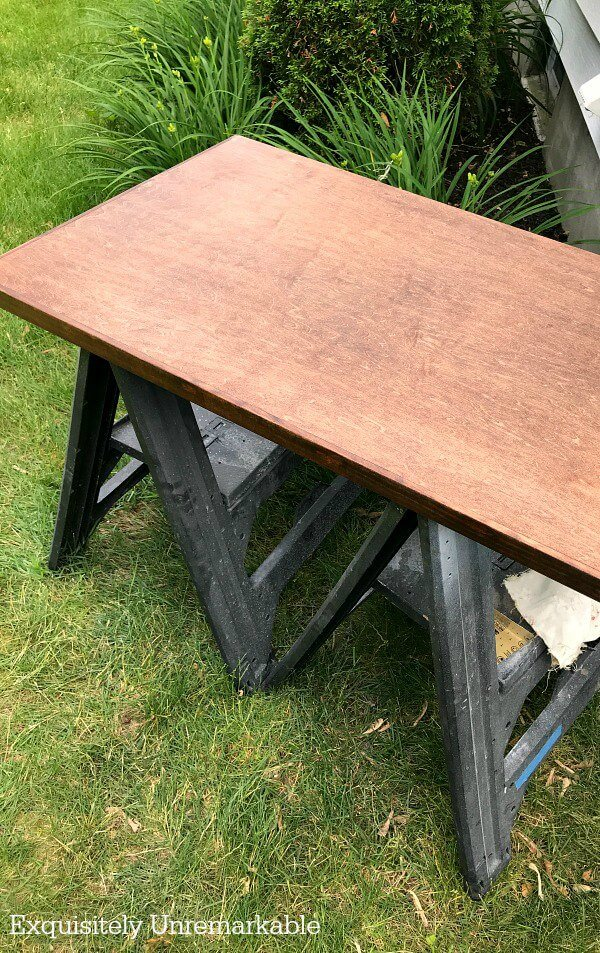 Staining A Wooden Countertop on two sawhorses