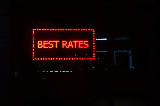 Lit sign showing best rates